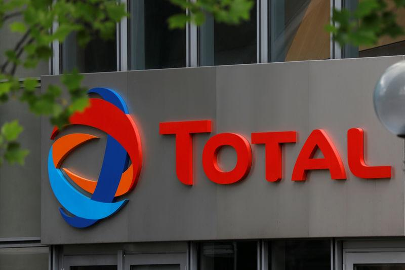 The logo of French oil giant Total is seen at La Defense business and financial district in Courbevoie