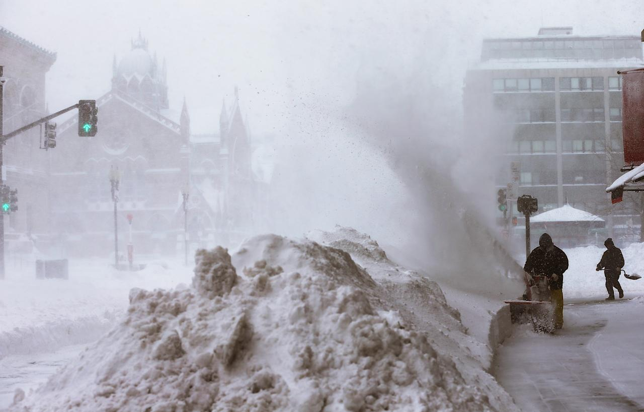 BOSTON, MA - FEBRUARY 09:  Workers clear snow from a sidewalk in the Back Bay neighborhood during a lingering blizzard on February 9, 2013 in Boston, Massachusetts. The powerful storm has knocked out power to 650,000 and dumped more than two feet of snow in parts of New England.  (Photo by Mario Tama/Getty Images)