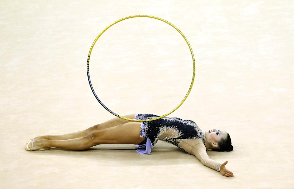 LONDON, ENGLAND - JANUARY 18: Anna Alyabyeva of Kazakhstan in action in the Individual All-Around Final during the FIG Rhythmic Gymnastics at North Greenwich Arena on January 18, 2012 in London, England. (Photo by Ian Walton/Getty Images)