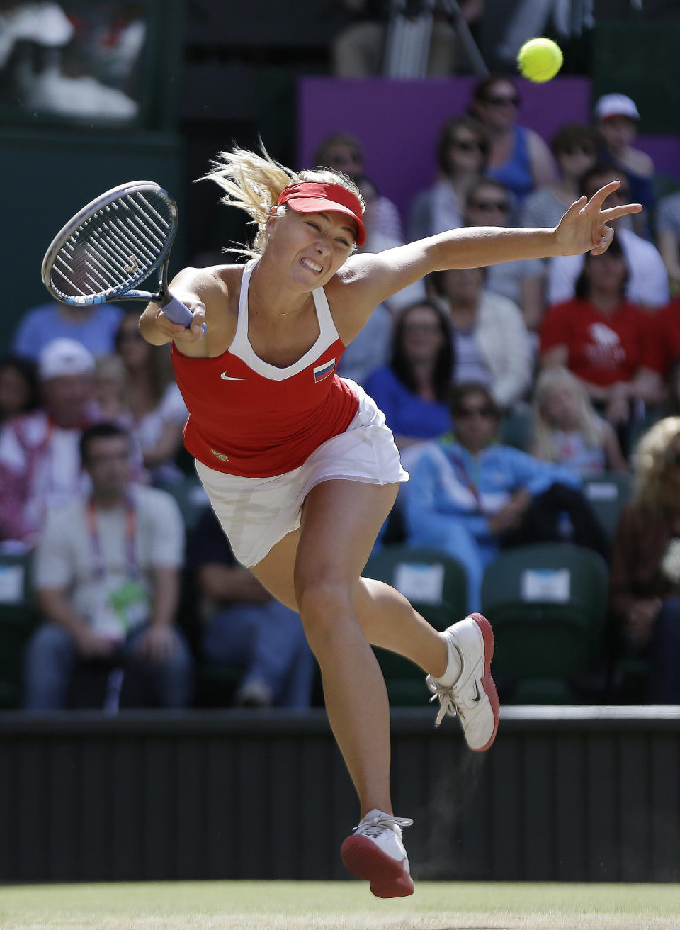 Maria Sharapova of Russia returns to Serena Williams of the United States at the All England Lawn Tennis Club in Wimbledon, London at the 2012 Summer Olympics, Saturday, Aug. 4, 2012. (AP Photo/Elise Amendola)