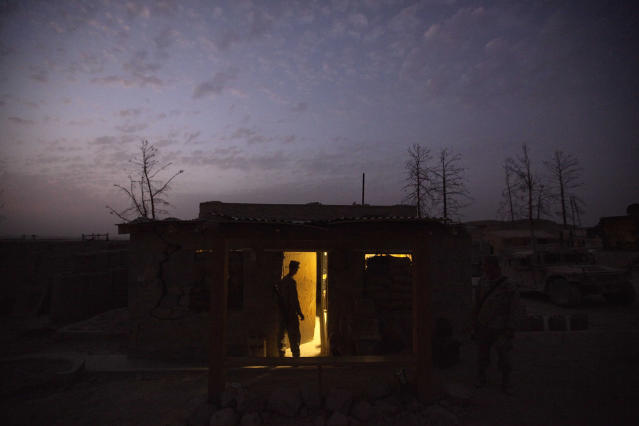 <p>U.S. Marine Lance Cpl. Matthew Timberlake, 20, of Roseville, Calif., with the 2nd Battalion 12th Marines based in Kaneohe Bay, Hawaii, stands in the doorway of his barrack on July 27, 2011 at Forward Operating Base Zeebrugge in Kajaki, Helmand province, Afghanistan. (AP Photo/David Goldman) </p>