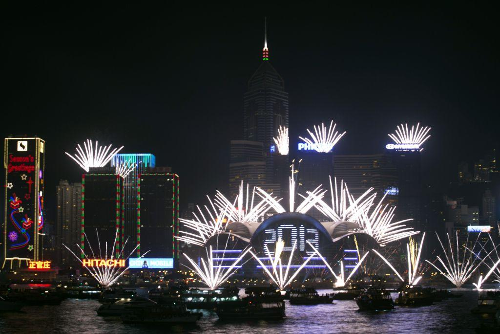 Fireworks light the sky over Victoria Harbour during a pyrotechnic show to celebrate the New Year in Hong Kong January 1, 2013.