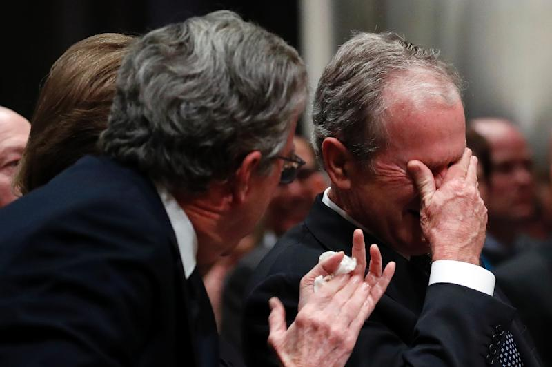 Former president George W. Bush weeps after delivering his eulogy at the state funeral for his father George H.W. Bush at Washington National Cathedral