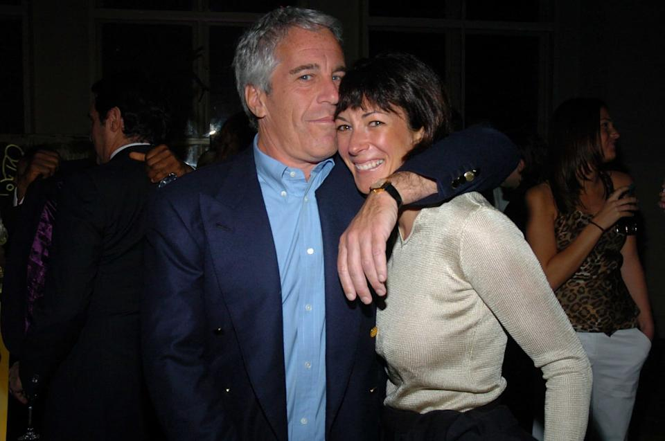 Jeffrey Epstein and Ghislaine Maxwell, pictured attending a concert in 2005 - Getty