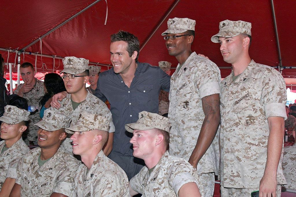 "Ryan Reynolds took a trip down to Marine Corps Air Station Miramar near San Diego, California, to show his support for the troops. The actor signed autographs and treated the Marines to a special screening of his newest blockbuster, ""Green Lantern."" Wonder if he stuck around to get any feedback ... Marine Corps Air Station Miramar /<a href=""http://www.pacificcoastnews.com/"" target=""new"">PacificCoastNews.com</a> - June 19, 2011"