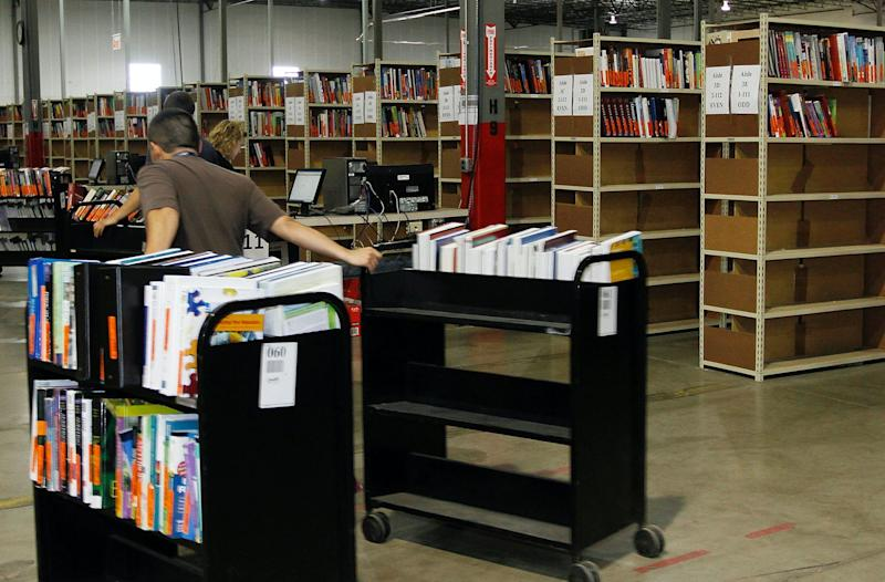 Employees restock returned textbooks at the Chegg Inc. warehouse in Shepherdsville, Kentucky, U.S., on Thursday, April 29, 2010. (Photo: John Sommers II/Bloomberg via Getty Images)