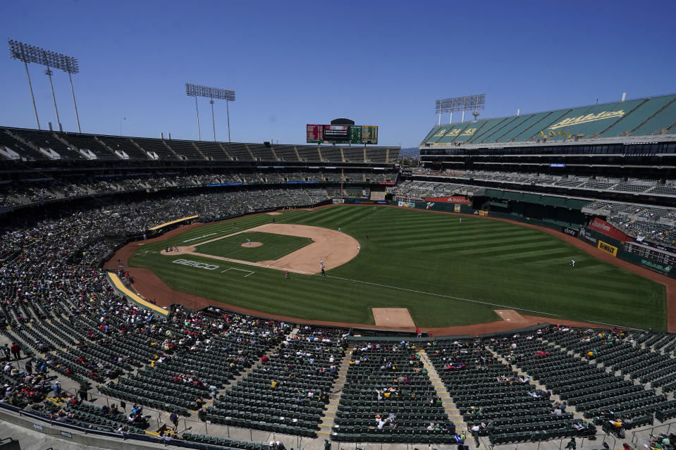 Fans watch as Oakland Athletics' James Kaprielian pitches against the Los Angeles Angels during the sixth inning of a baseball game in Oakland, Calif., Tuesday, July 20, 2021. (AP Photo/Jeff Chiu)