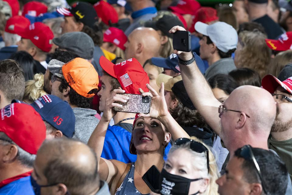 Attendees wait for Trump at a campaign rally.