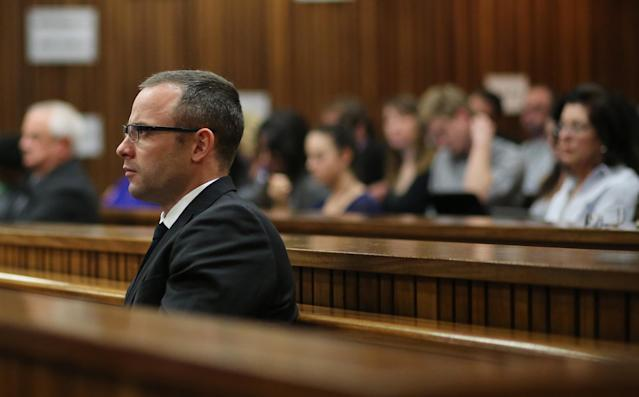 Oscar Pistorius, looks straight ahead during his ongoing murder trial in Pretoria, South Africa, Tuesday, May 13, 2014. Pistorius is charged with the shooting death of his girlfriend Reeva Steenkamp on Valentine's Day in 2013. (AP Photo/Themba Hdebe, Pool)