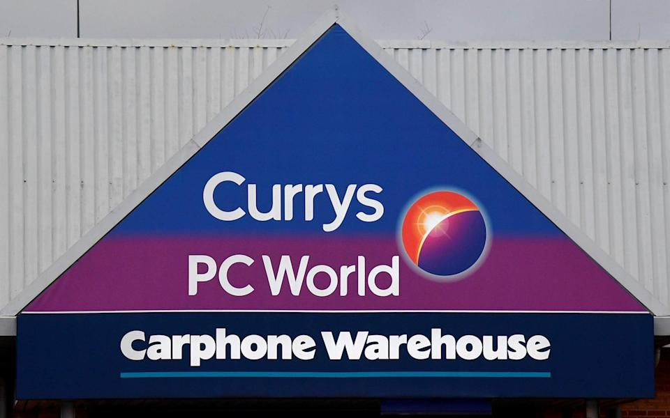 Signage is seen on the outside of a Currys PC World Carphone Warehouse electronics retail store - TOBY MELVILLE/REUTERS