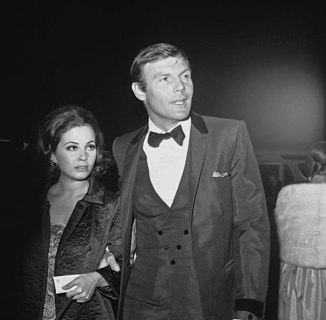 "<p>Adam West, who plays television's Batman, and Barbara Parkins of ""Peyton Place"" arrive for the premiere of ""The Blue Max"" in Hollywood, June 28, 1966. (Photo: Harold P. Matosian/AP) </p>"