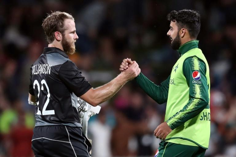 New Zealand's Kane Williamson and Pakistan's Shadab Khan (right) shake hands after the second T20 match