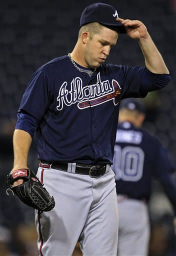 Atlanta Braves pitcher Paul Maholm walks back to the mound after giving up a solo home run to Pittsburgh Pirates' Starling Marte in fifth inning of a baseball game in Pittsburgh, Monday, Oct. 1, 2012. The Pirates won 2-1. (AP Photo/Gene J. Puskar)