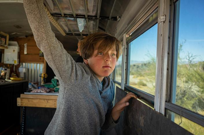 """Max looks out at neighboring busses on Feb. 20.<span class=""""copyright"""">Nina Riggio for TIME</span>"""