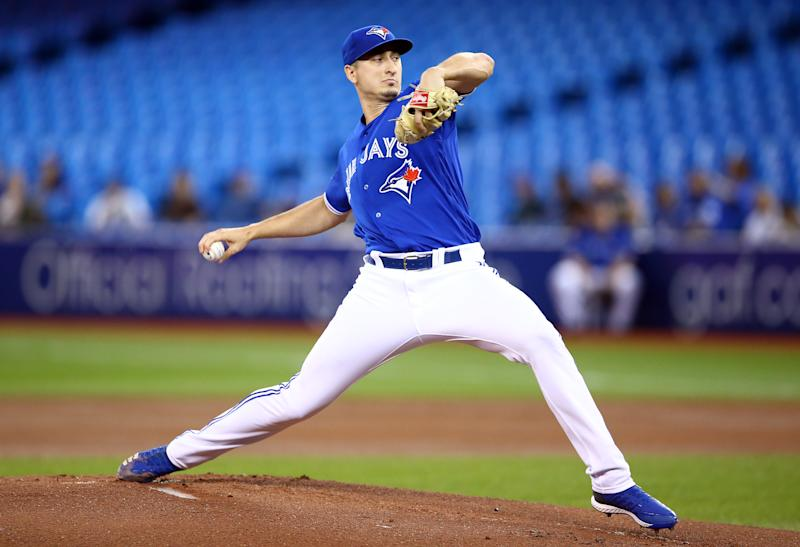 TORONTO, ON - SEPTEMBER 25: Jacob Waguespack #62 of the Toronto Blue Jays delivers a pitch in the first inning during a MLB game against the Baltimore Orioles at Rogers Centre on September 25, 2019 in Toronto, Canada. (Photo by Vaughn Ridley/Getty Images)