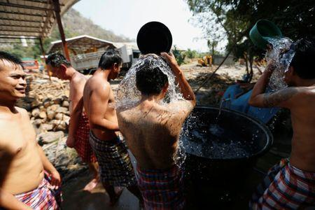 Patients take a cool shower after having a steam bath at the rehabilitation area at Wat Thamkrabok monastery in Saraburi province, Thailand, February 8, 2017. REUTERS/Jorge Silva