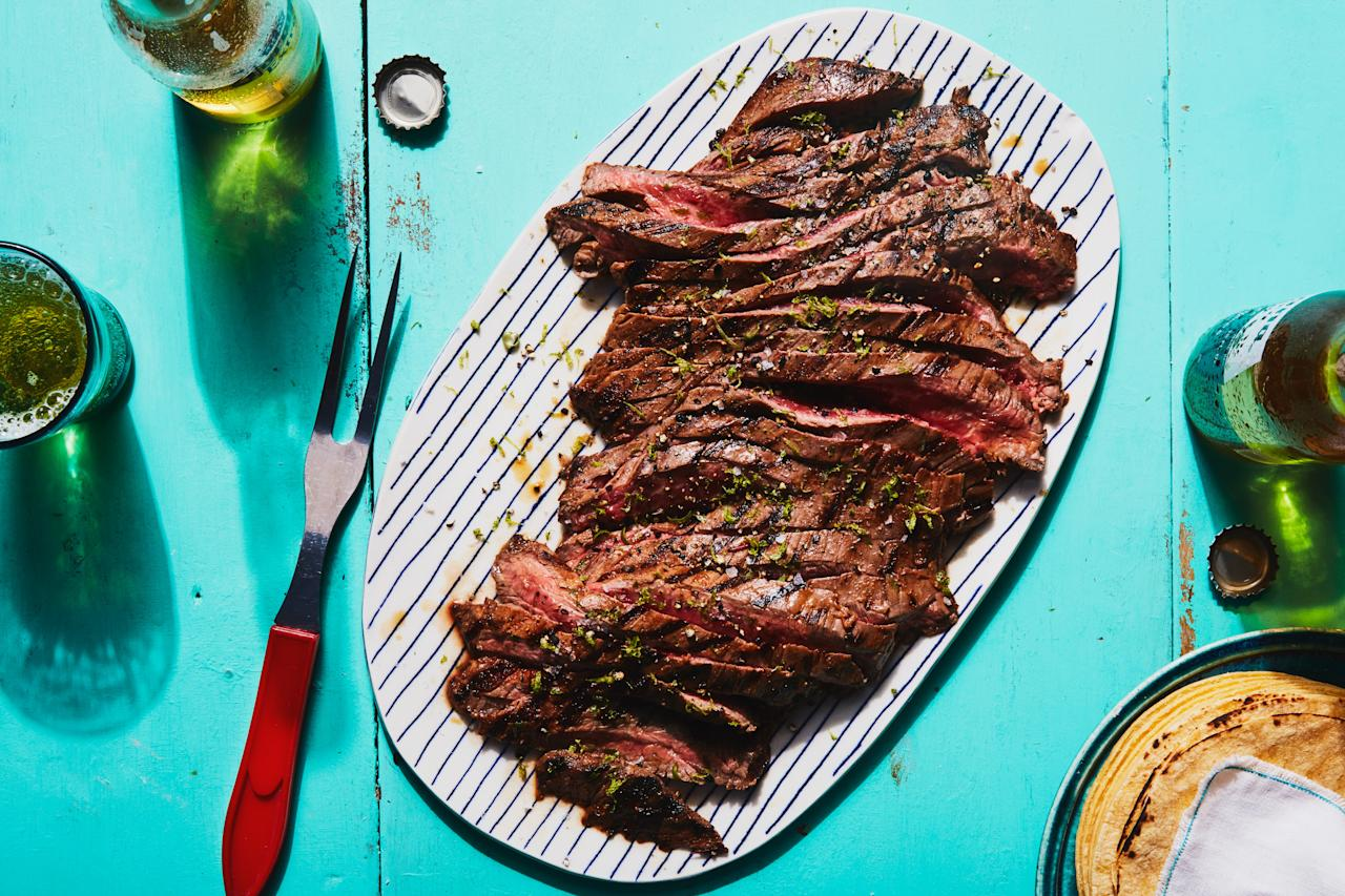 """Serve this versatile grilled steak over rice or set it out with tortillas and all the toppings for an easy 4th of July taco bar. <a href=""""https://www.epicurious.com/recipes/food/views/3-ingredient-chipotle-lime-grilled-steak?mbid=synd_yahoo_rss"""">See recipe.</a>"""