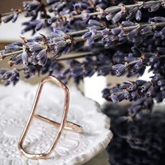 """This Illinois-based Amazon Handmade shop specializes in dainty handcrafted jewelry. Find this <a href=""""https://amzn.to/2CU57Pt"""" rel=""""nofollow noopener"""" target=""""_blank"""" data-ylk=""""slk:gold geometric ring"""" class=""""link rapid-noclick-resp"""">gold geometric ring</a> for $64."""