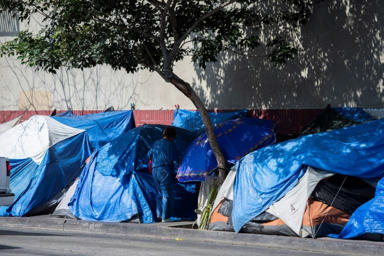 Tents line the street in Skid Row in Los Angeles, California on September 17, 2019 (AFP Photo/Robyn Beck)