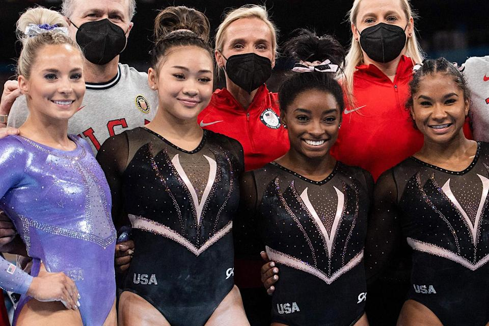"""<p>While most athletes had lodging at the Olympic Village, both the men's and women's gymnastics teams opted to stay at a hotel near their competition venue, Tokyo's Ariake Gymnastics Center.</p> <p>On July 22, during their official practice session days ahead of prelims, Biles <a href=""""https://people.com/sports/tokyo-olympics-simone-biles-nails-yurchenko-double-pike-vault-at-podium-training/#:~:text=ESPN%20called%20the%20move%20%22the,flip%20%E2%80%93%20and%20level%20of%20difficulty."""" rel=""""nofollow noopener"""" target=""""_blank"""" data-ylk=""""slk:successfully executed her riskiest stunt"""" class=""""link rapid-noclick-resp"""">successfully executed her riskiest stunt</a> — the Yurchenko double pike on vault. The dangerous move consists of a round-off onto the springboard, back handspring onto the vaulting table, and a second flip done in the pike position. (By adding flips instead of twists, the chances of landing on your head or neck increase drastically.)</p> <p>Biles first debuted the Yurchenko double pike vault in competition at the U.S. Classic in May.</p>"""