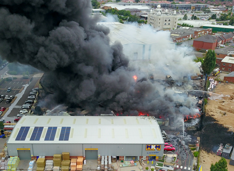 Smoke and toxic fumes billow from the industrial estate blaze. (SWNS)