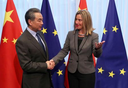Chinese Foreign Minister Wang Yi is welcomed by EU High Representative for Foreign Affairs and Security Policy Federica Mogherini ahead of a meeting in Brussels, Belgium March 18, 2019.  REUTERS/Yves Herman