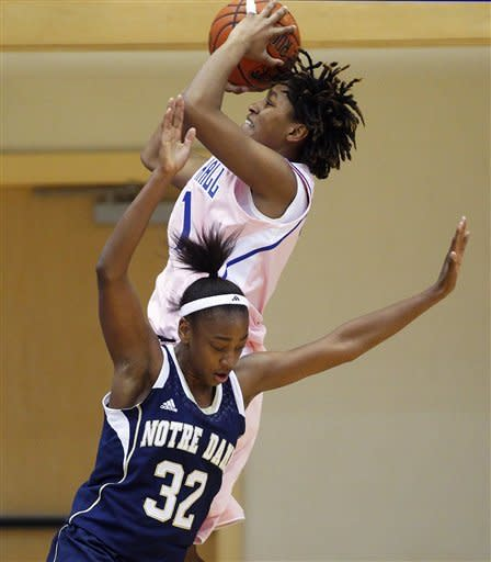 Seton Hall's Tabatha Richardson-Smith (1) takes a shot next to Notre Dame's Jewell Loyd (32) during the first half of an NCAA college basketball game in South Orange, N.J. Saturday, Feb. 9, 2013. (AP Photo/Rich Schultz)