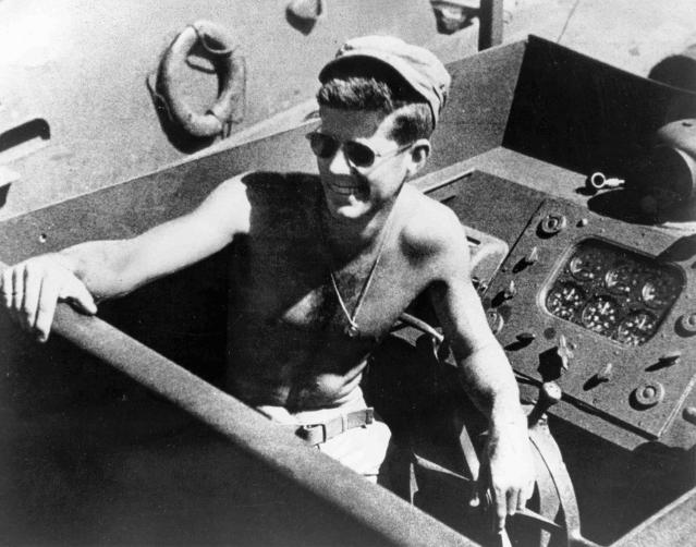 <p>Lt. j.g. John F. Kennedy aboard the PT-109 torpedo boat in the South Pacific in 1943. (Photo: John F. Kennedy Presidential Library and Museum) </p>
