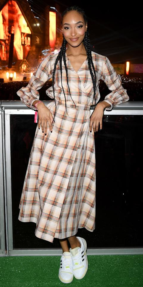 <p>Jourdan Dunn paired a plaid wrap dress with Adidas sneakers during the MDL Beast Festival in Riyadh.</p>