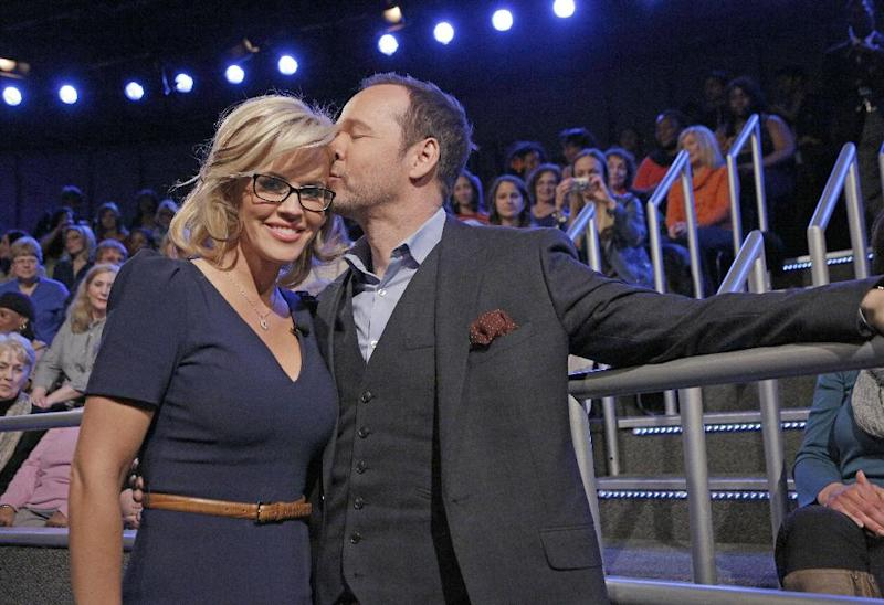 """This image released by ABC shows co-host Jenny McCarthy with her fiance Donnie Wahlberg after she announced her engagement on the daytime series """"The View,"""" Wednesday, April 16, 2014 in New York. (AP Photo/ABC, Heidi Gutman)"""