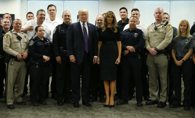 <p>President Donald Trump and first lady Melania Trump pose with police at the Las Vegas Metropolitan Police Department in the wake of the mass shooting in Las Vegas, Nev., Oct. 4, 2017. (Photo: Kevin Lamarque/Reuters) </p>