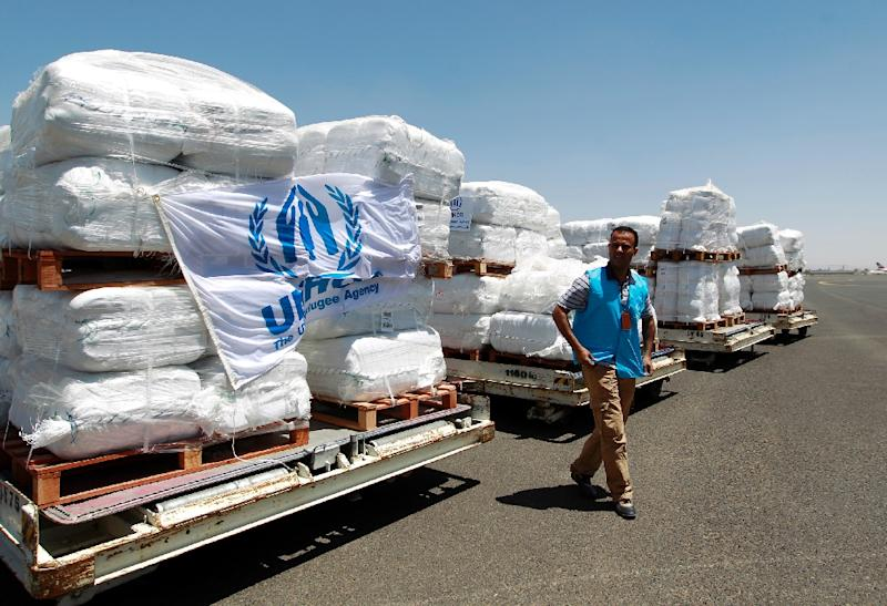 Emergency medical aid provided by United Nations High Commissioner for Refugees (UNHCR) is seen being unloaded at the international airport in Sanaa earlier this month