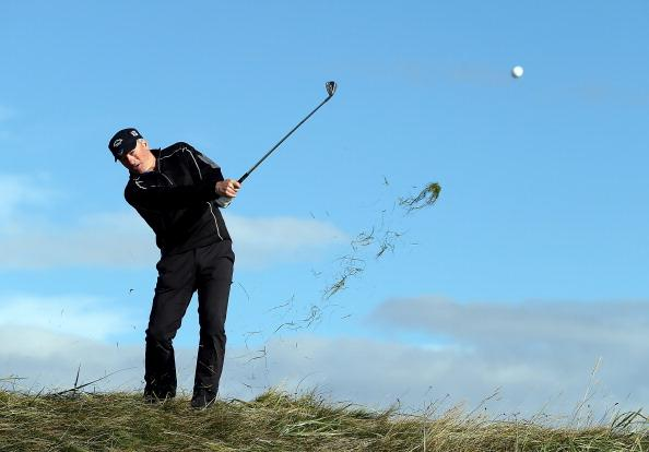 CARNOUSTIE, SCOTLAND - OCTOBER 05:  Former Austrlian cricket captain Steve Waugh plays out from the rough on the second hole during the second round of The Alfred Dunhill Links Championship at Carnoustie Golf Links on October 5, 2012 in Carnoustie, Scotland.  (Photo by Richard Heathcote/Getty Images)