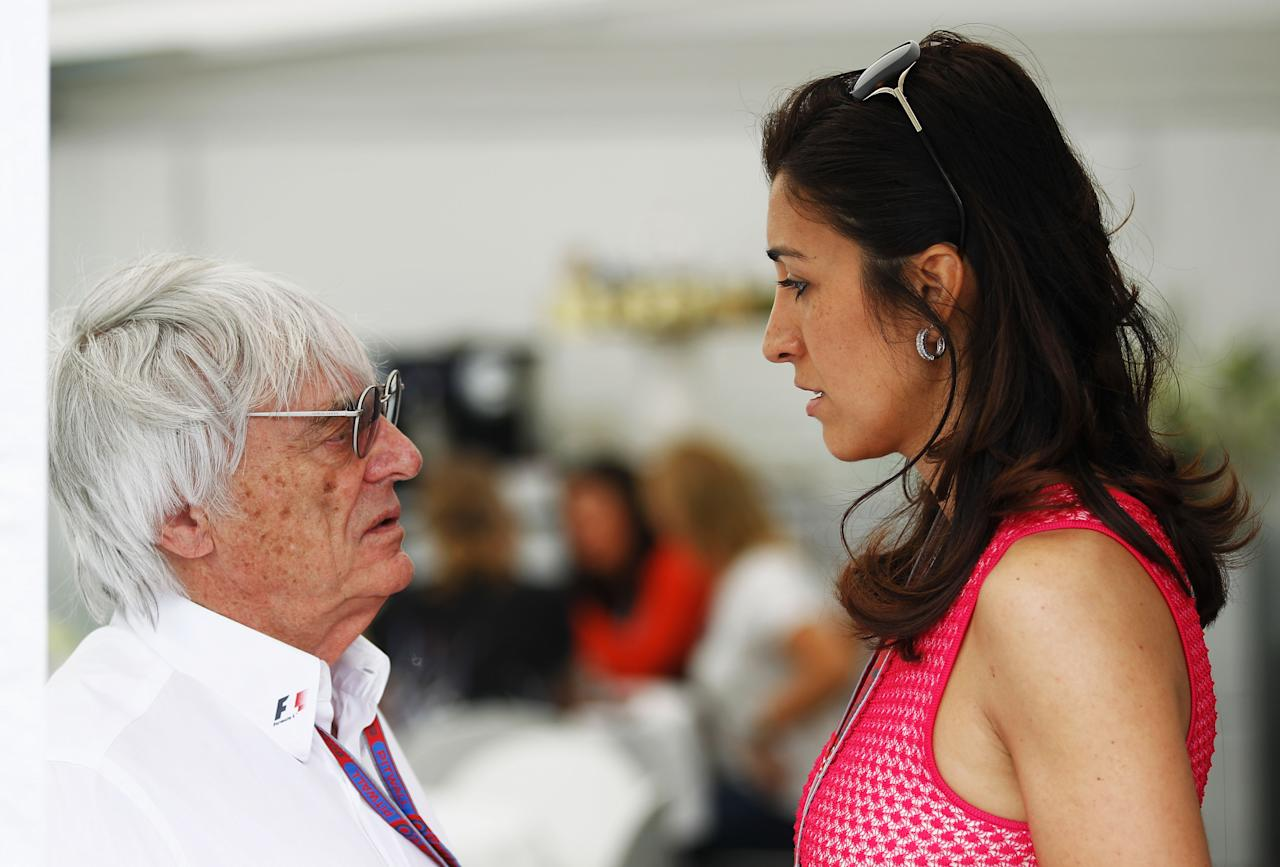 BARCELONA, SPAIN - MAY 13:  F1 supremo Bernie Ecclestone and his fiancee Fabiana Flosi are seen in the paddock before the Spanish Formula One Grand Prix at the Circuit de Catalunya on May 13, 2012 in Barcelona, Spain.  (Photo by Paul Gilham/Getty Images)