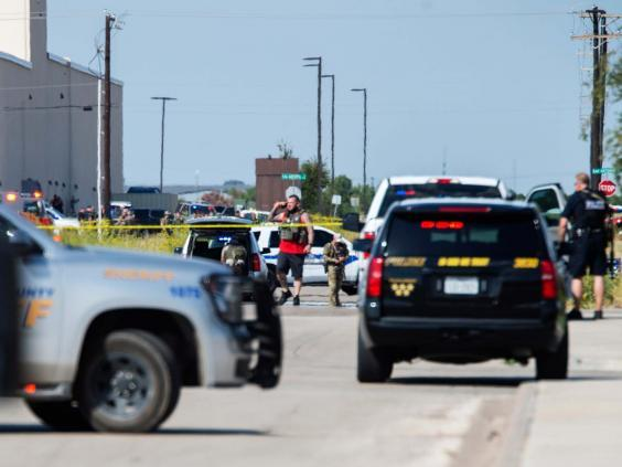 Police surround the area behind Cinergy in Odessa (AP)