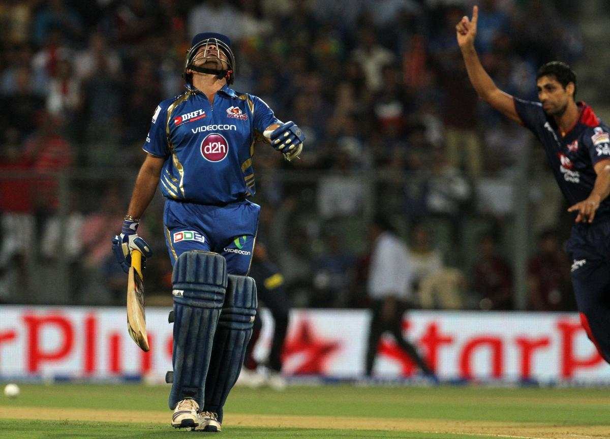 Mumbai Indian player Sachin Tendulkar reacts after getting run out during match 10 of the Pepsi Indian Premier League ( IPL) 2013  between The Mumbai Indians and the Delhi Daredevils held at the Wankhede Stadium in Mumbai on the 9th April 2013 ..Photo by Vipin Pawar-IPL-SPORTZPICS ..Use of this image is subject to the terms and conditions as outlined by the BCCI. These terms can be found by following this link:..https://ec.yimg.com/ec?url=http%3a%2f%2fwww.sportzpics.co.za%2fimage%2fI0000SoRagM2cIEc&t=1506344970&sig=gu8dviuIWbPDU28g1eSGYQ--~D