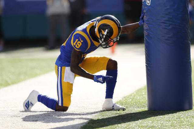 Los Angeles Rams wide receiver JoJo Natson kneels after scoring a touchdown against the Dallas Cowboys during the first quarter of a preseason NFL football game Saturday, Aug. 17, 2019, in Honolulu. (AP Photo/Marco Garcia)
