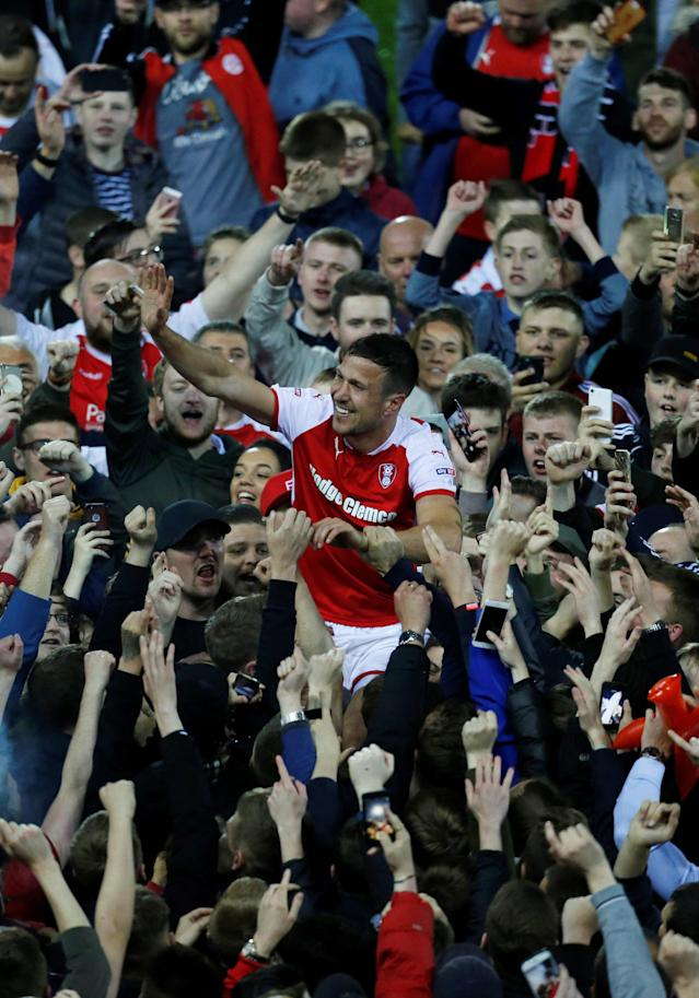 "Soccer Football - League One Play Off Semi Final Second Leg - Rotherham United vs Scunthorpe United - AESSEAL New York Stadium, Rotherham, Britain - May 16, 2018 Rotherham United's Richard Wood celebrates with fans after the match Action Images/Ed Sykes EDITORIAL USE ONLY. No use with unauthorized audio, video, data, fixture lists, club/league logos or ""live"" services. Online in-match use limited to 75 images, no video emulation. No use in betting, games or single club/league/player publications. Please contact your account representative for further details."
