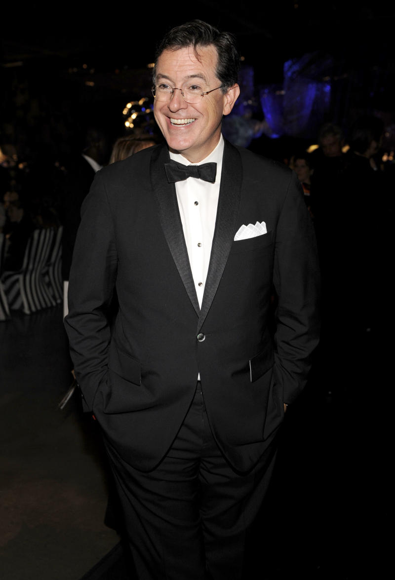 "FILE - This Sept. 18, 2011 file photo shows Stephen Colbert at the 63rd Primetime Emmy Awards Governors Ball in Los Angeles. Colbert is hosting another music extravaganza, and this time, he's got missiles. The comedian announced Tuesday, July 31, 2012, on ""The Colbert Report"" that he will host a concert on Aug. 10 aboard the Intrepid Sea, Air and Space Museum in New York. Performing will be the Flaming Lips, Santigold, Grandmaster Flash, Grizzly Bear and the band fun. (AP Photo/Chris Pizzello, file)"