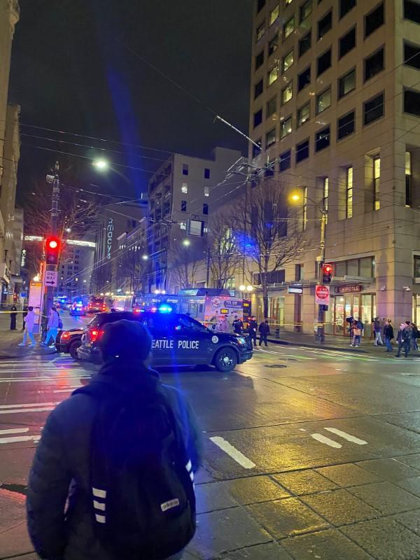 Police block a road following a shooting in Seattle