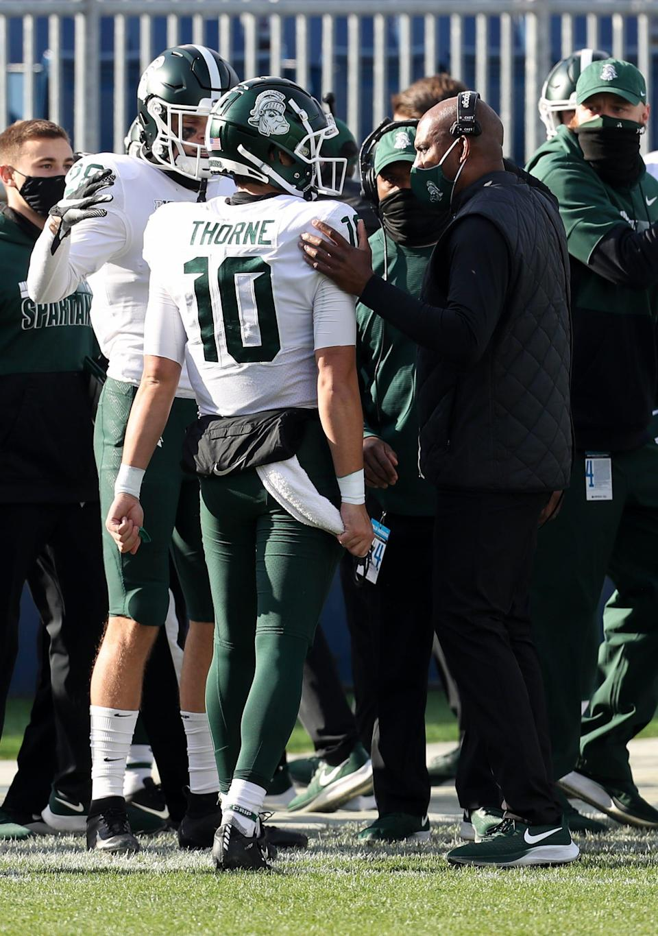 Michigan State coach Mel Tucker talks with quarterback Payton Thorne during the second quarter against Penn State at Beaver Stadium, Dec. 12, 2020 in University Park, Pa.