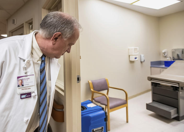 Dr. Donald Yealy, UPMC's chair of emergency medicine, gives a tour of UPMC Mercy's South Side Outpatient Center, which will be used as a COVID-19 specimen collection site. (Steph Chambers/Pittsburgh Post-Gazette via AP)