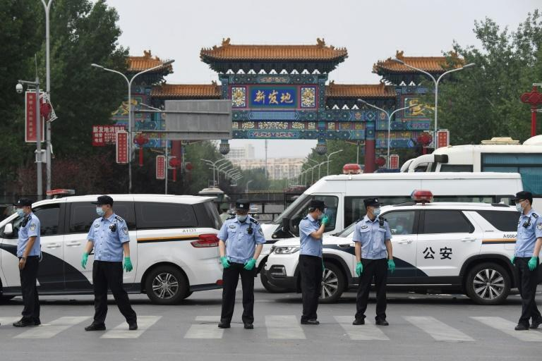 A new cluster of cases in Beijing has been linked to the Xinfadi wholesale market (AFP Photo/GREG BAKER)