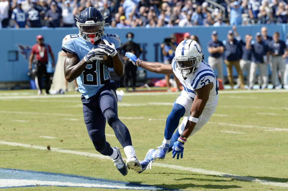 Tennessee Titans wide receiver Chester Rogers (80) catches a touchdown pass ahead of Indianapolis Colts cornerback Kenny Moore II (23) in the first half of an NFL football game Sunday, Sept. 26, 2021, in Nashville, Tenn. (AP Photo/Mark Zaleski)