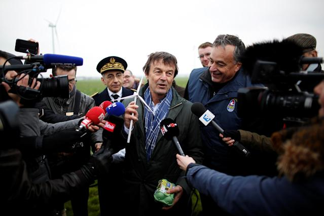 French Minister for Ecological and Inclusive Transition Nicolas Hulot talks to journalists as he attends a visit at a wind farm in Juille near Le Mans, France January 8, 2018. REUTERS/Stephane Mahe