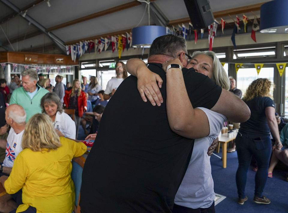 Eilidh McIntyre's friends and family celebrate her win at Hayling Island Sailing Club, Hampshire (Steve Parsons/PA) (PA Wire)