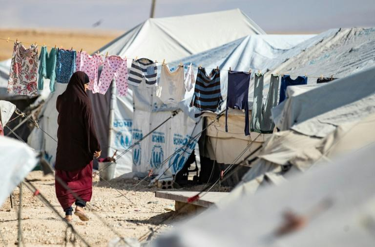 Security is tight at Al-Hol camp, and the detainees held there hope the Turkish offensive will set them free (AFP Photo/Delil SOULEIMAN)