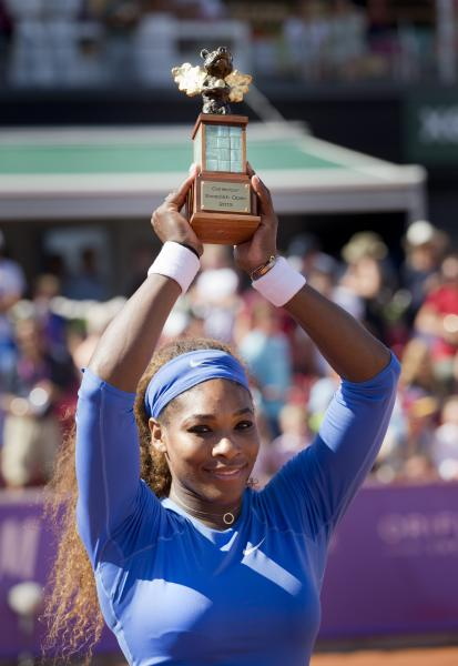 Serena Williams poses with the trophy after winning her 53rd WTA title by beating Johanna Larsson, not shown, by 6-4, 6-1 in the final of the Swedish Open on Sunday, July 21, 2013 in Bastad, Sweden. (AP Photo/Bjorn Larsson Rosvall, Scanpix) SWEDEN OUT