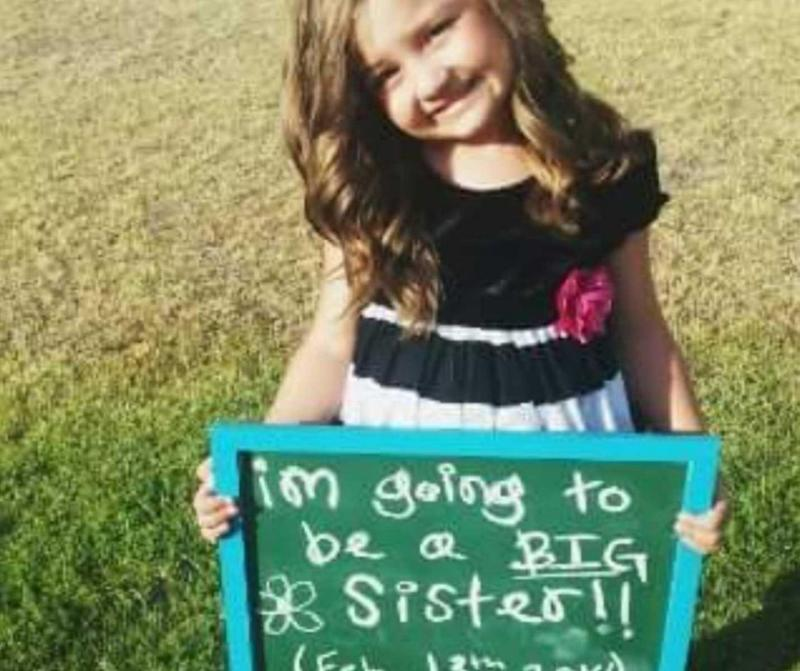 "She took a picture of Brooke standing in the garden with a sign that read 'I'm going to be a big sister"" in her hands and posted it straight to Facebook. Photo: Kelsey Davis"