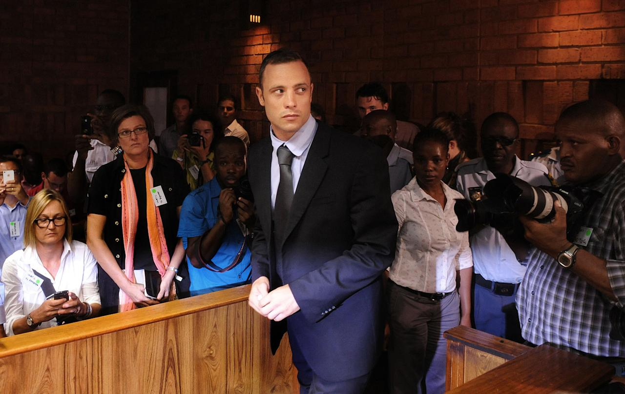 "FILE - In this Feb. 22, 2013 file photo, Olympic athlete Oscar Pistorius arrives for a bail hearing in the shooting death of his girlfriend, Reeva Steenkamp. Pistorius' representatives on Wednesday, Feb. 27, 2013 named the substance found in his bedroom after the shooting death of his girlfriend as Testis compositum, and say it is an herbal remedy used ""in aid of muscle recovery."" South African police say they found needles in Pistorius' bedroom along with the substance, which they initially named as testosterone. Prosecutors later withdrew that statement identifying the substance and said it had been sent for laboratory tests. (AP Photo, File)"